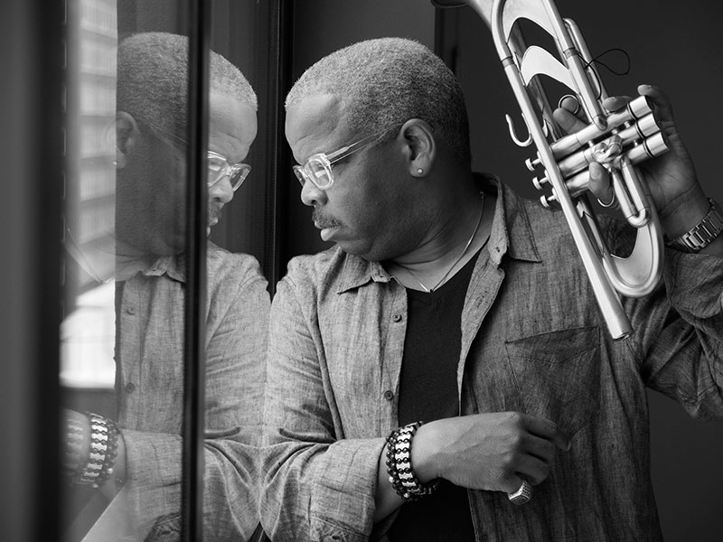 TB-LOOKING-OUT-WINDOW-WITH-TRUMPET.-PHOTO-BY--Henry-Adebonojo